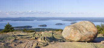 Granite rocks and view of Bar Harbor from Cadillac Mountain at Acadia National Park Royalty Free Stock Images