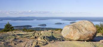 Granite rocks and view of Bar Harbor from Cadillac Mountain at Acadia National Park Royalty Free Stock Images