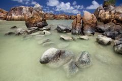Granite rocks in the water Royalty Free Stock Images