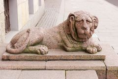 Granite sculpture of the lion. One of two granite lions at the entrance to the building of the Constitutional Court of the Russian Federation on English royalty free stock photography