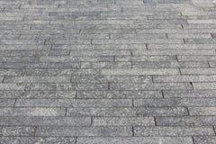 Granite sidewalk. Grey solid granite sidewalk background. Stone pavement pattern Stock Photo