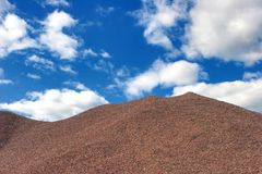 Granite-sifting hill and sky Royalty Free Stock Image