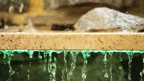 Granite slab with stones and waters. Drops of water flowing down from granite slabs stock footage