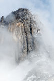 Granite spire surrounded by clouds. California, Yosemite National Park, Taken 11.16 Copyright David Hoffmann Stock Photography