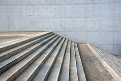 Granite stairs and a concrete wall. Grey granite stairs and a concrete wall Royalty Free Stock Photography