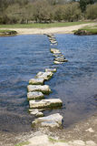 Granite stepping stones cross a river stock photo
