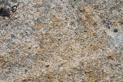 Granite stone. Close-up of a granite stone; rough texture stock photography