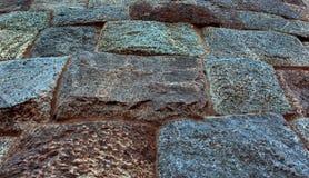 Granite stone block ancient fort  wall texture background. Granite stone block ancient fort wall texture background photo with evening light Stock Image