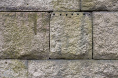 Granite Stone Block Wall, weathered with quarry marks Stock Images