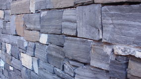 Granite stone brick wall. Granite blue and grey stone brick wall. White stone Stock Photography