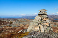 Granite stone cairn as a navigation mark Stock Photos