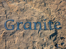 Granite Stone. Carved in pavement Stock Photo