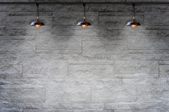 Granite stone decorative brick wall with lamp Royalty Free Stock Image