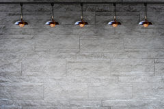 Granite stone decorative brick wall with lamp Royalty Free Stock Photo