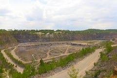 Granite stone extraction in the quarry Stock Photos