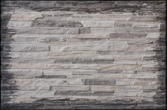 Granite stone gray decorative brick wall Royalty Free Stock Image