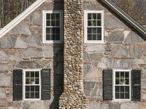 Granite and Stone House Gable. An old Vermont house construction of Granite stones for walls, and small river stones for the chimney Royalty Free Stock Photo