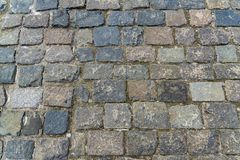 Granite stone pavement texture. Abstract background of old cobbl stock images