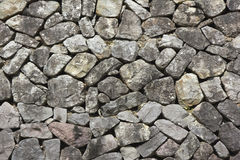 Granite stone slab wall Stock Images