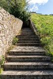 Granite Stone stair in park. Steps going a long way up into a tunnel royalty free stock photos