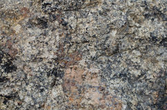Granite a stone structure. Old granite rock a structure of a stone a background Royalty Free Stock Photo