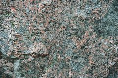 Granite stone texture. The texture of the granite stone is pink. Relief sad background royalty free stock photos