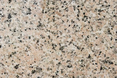 Granite stone. Texture of granite rock in pink black and white Royalty Free Stock Photos