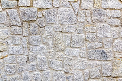 Granite stone wall. Granite rustic stone wall beautifully preserved in a shiny day Stock Image