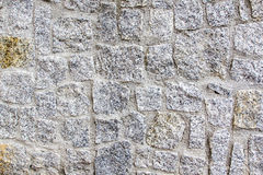 Granite stone wall. Granite rustic stone wall beautifully preserved in a shiny day Stock Photo