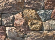Granite stone wall texture and background stock photos