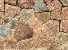 Granite stone wall texture and background royalty free stock image