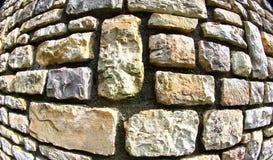 Stone wall using fish eye lens. Granite stone wall using fish eye lens royalty free stock images
