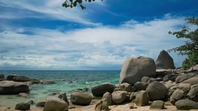 Granite stones on the beach of an tropical island. Clouds are movig over the sea. Koh Tao, Thailand.  stock video