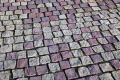 Granite stones. Square granite stones on the pavement Stock Photography