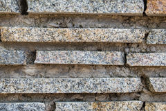 Granite stripes and concrete wall background, texture royalty free stock image