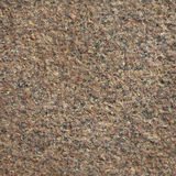 Granite texture. Brown Granite texture on earth Royalty Free Stock Photography