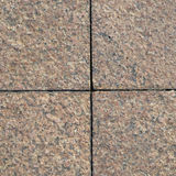 Granite texture. Brown Granite texture on earth Royalty Free Stock Photos