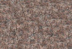 Granite texture maroon in speckles natural uneven surface endless Stock Photography