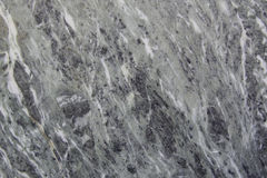 Granite texture. Photo of a homogeneous texture of polished white granite Royalty Free Stock Image