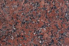 Granite Texture. Reddish-brown base with black and gray spots. Used as a background. Copy space for your text Stock Photo