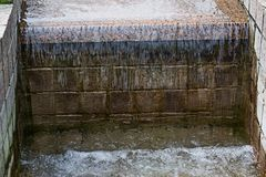 Granite threshold of an artificial waterfall royalty free stock photo