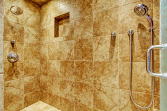 Granite tile wall trim in luxury bathroom. With shower head Stock Image