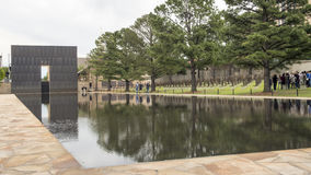 Granite walkway, reflective pool with 9:01AM wall and Field of Empty Chairs, Oklahoma City Memorial Royalty Free Stock Image