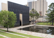 Granite walkway, reflective pool with 9:01AM wall and Field of Empty Chairs, Oklahoma City Memorial Royalty Free Stock Photography