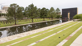 Granite walkway, reflective pool with 9:03AM wall and Field of Empty Chairs, Oklahoma City Memorial Royalty Free Stock Photos
