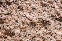 Granite wall 2. Extreme closeup of a portion of a red, white and black granite wall for backgrounds Royalty Free Stock Photo