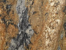 Granite wall. A granite stone wall, slab, closeup, background Stock Images