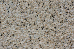 Granite Wall of Light Yellow Color and Black Dots. Rough Surface of Granite Wall of Light Yellow Color and Black Dots Royalty Free Stock Photo