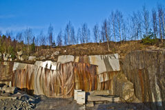 Granite wall in a quarry. The wall is in the jogra quarry at iddefjord in halden municipality and shows how the iron in the granite has rusted and forming a fine Royalty Free Stock Image