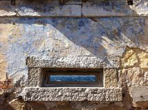 Granite window in old fortification with sea panorama, Caprera I Royalty Free Stock Photo